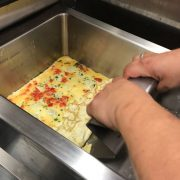 Omelette being scraped out of the VarioCooking Centre with scraper