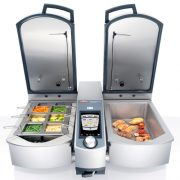 VarioCooking Centre 112L with both lids open cooking vegetables and fish
